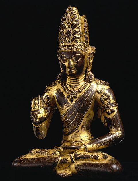 11th century circa, Tibet, Amoghasiddhi, gilt copper.